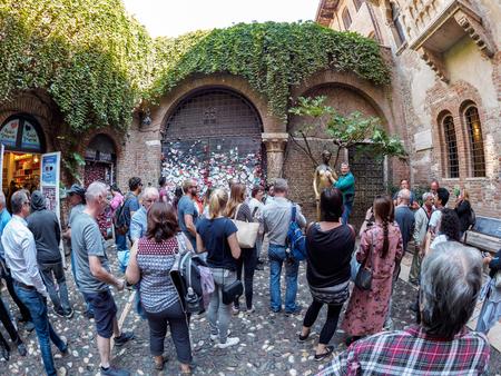 Verona, Italy - October 02: tourists visit the statue of giulietta on October 02, 2017 in Verona
