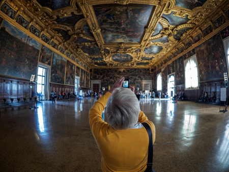 Venice - October 04: Unknown tourist makes a photo in the Palazzo Ducale on October 04, 2017 in Venice