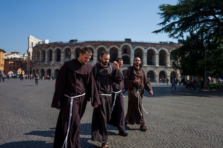 Verona, Italy - October 02: Unknown monks take a walk in front of arena on October 02, 2017 in Verona Editorial