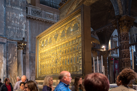 Vernice - October 05: tourists visit the famous Pala Doro in the Basilica die San Marco on October 05, 2017 in Venice Editorial