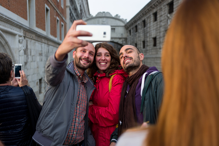 Venice - October 04: Unknown tourists make a selfie in front of the famous Ponte dei Sospiri bridge on October 04, 2017 in Venice Editorial