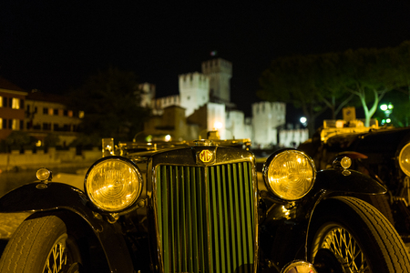 Sirmione - September 30: Morris Garages vintage car parks in front of Sirmione castle for Memorial Morandi event on September 30, 2017 in Sirmione