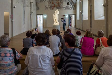 Milan - September 28: Tourists gaze at the unfinished statue of Michelangelo in the Pieta Rondandini on September 28, 2017 in Milan