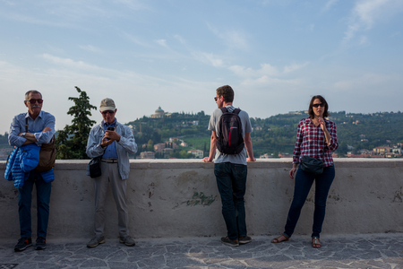 Verona, Italy - October 02: Unknown tourists enjoy the view over Verona on October 02, 2017 in Verona