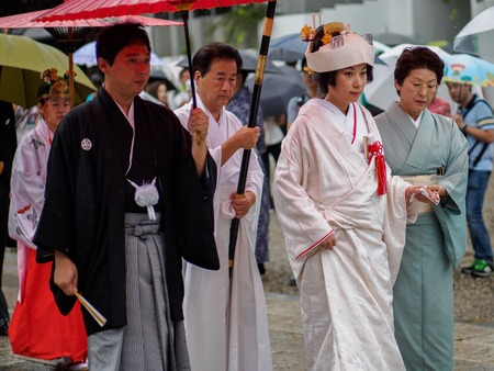 Kyoto, Japan - October 03: Unknown Japanese bride walks the street in the rain on her weeding on October 03, 2016 in Kyoto, Japan