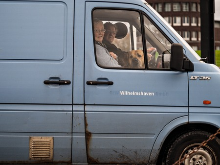 Wilhelmshaven, Germany - December 23: Unidentified couple sit with their dog in car on December 23, 2014 in Wilhelmshaven, Germany