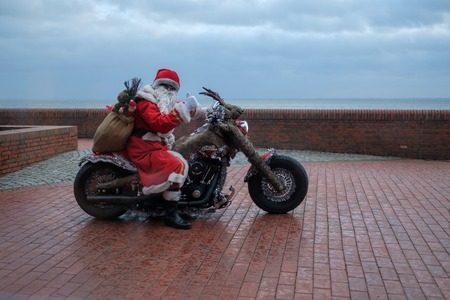 Wilhelmshaven, Germany - December 24: Unidentified biker dresses as Santa Claus for Christmas at the South Beach on December 24, 2016 in Wilhelmshaven, Germany Editorial