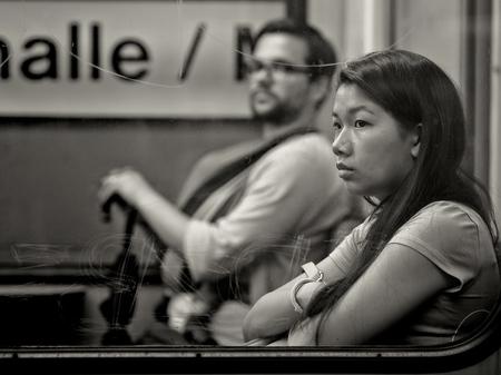 Frankfurt, Germany - August 21: Unidentified asian girl in metro ln August 21, 2014 in Frankfurt, Germany