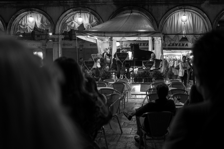 Venice, Italy - October 04: Musicians play for tourists at night on the Piazza San Marco on October 04, 2017 in Venice, Italy.