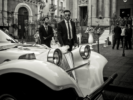 Catania, Italy - October 14: Grim man looks at camera at Italian wedding on October 14, 2014 in Catania, Italy.