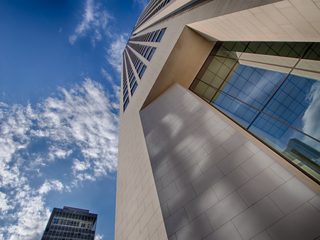 Frankfurt, Germany - August 16: Wide angle view on the Opernturm with BHF Bank in background on August 16, 2014 in Frankfurt, Germany.