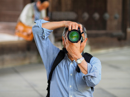 Kayoto, Japan - May 11: Unidentified man makes photo the photographer on May 11, 2014 in Kyoto, Japan.