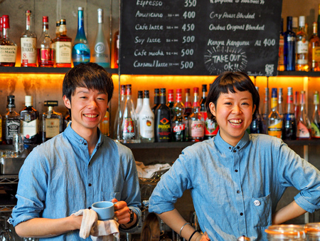 Tokyo, Japan - May 06: Uidentified friendly staff at Nui Hostel smiles at camera on May 06, 2014 in Tokyo, Japan.