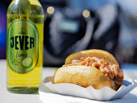 Wilhelmshaven, Germany - April 19: A biscuit with prawns and a Jever beer in the sun on April 19, 2014 in Wilhelmshaven, Germany.