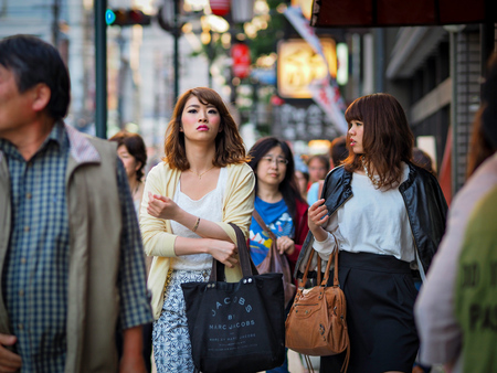 Kyoto, Japan - May 13: Two unidentified girls walking the streets of Downtown Kyoto on May 13, 2015 in Kyoto, Japan. Editorial