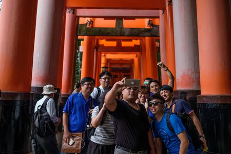 Kyoto, Japan - October 02: Unidentified tourists take selfie in Fushimi Inari-Taisha on October 02, 2016 in Kyoto, Japan.