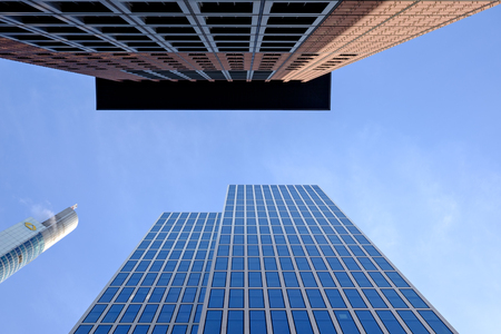 Frankfurt, Germany - November 12: View to the sky with Commerzbank and and Japan tower in the financial district on November 12, 2015 in Frankfurt, Germany.