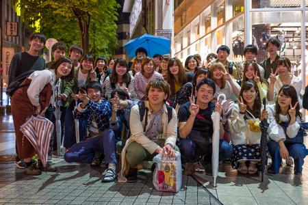 Kumamoto, Japan - May 12: Group of young people poses for the camera on May 12, 2017 in Kumamoto, Japan.