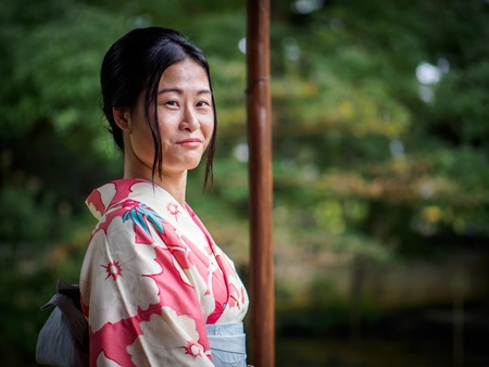 Kyoto, Japan - October 03: Unidentified female tourist in tradional Japanese clothes smiles in Shoren-In temple on October 03, 2015 in Kyoto, Japan.