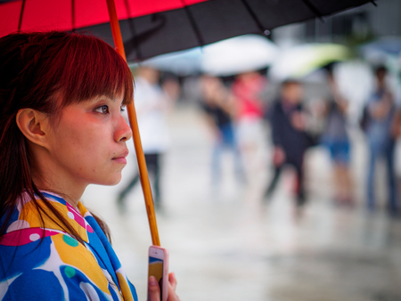 Kyoto, Japan - October 03: Unidentified female tourist in tradional Japanese clothes with umbrella in Shoren-In temple on October 03, 2015 in Kyoto, Japan.