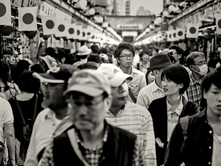 Tokyo, Japan - May 03: Unidentified tall Japanese man walks with the crowds on the Nakamise street near Sensoji Temple on May 03, 2015 in Tokyo, Japan. Editorial