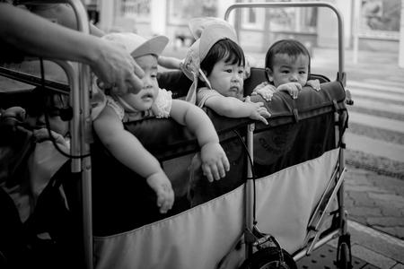 Naha, Japan - November 16: A wagon full of unidentified kids on the streets on November 16, 2015 in Naha, Japan. Editorial