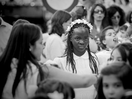 Madrid, Spain - June 07: Unidentified girl in catholic prosession on June 07, 2015 in Madrid, Spain.