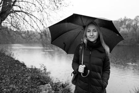 Blonde girl with umbrella in Kranichstein, Germany Standard-Bild - 90109384