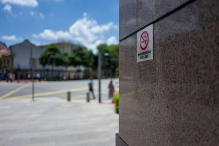 A Singapore no smoking by law sign Stock Photo