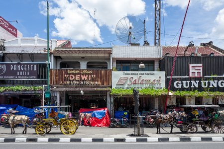 Yogyakarta, Indonesia - Horse-drawn carriages wait for customers on Malioboro Road in Yogyakarta.