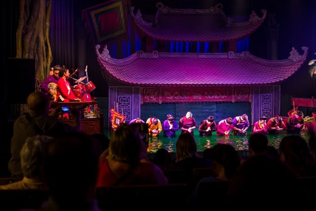 Hanoi, Vietnam - April 16, 2018: Performer at Water puppet theater bow in front of the audience in Hanoi Standard-Bild - 104685429