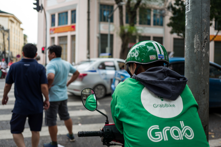 Hanoi, Vietnam - April 15, 2018: Grab driver waits for Clients on the streets of Hanoi. Standard-Bild - 104685430