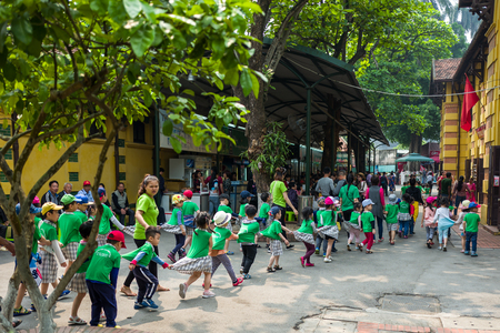 Hanoi, Vietnam - April 14, 2018: Young students play in the area of the Ho chi Minh Museum in Hanoi, Vietnam.