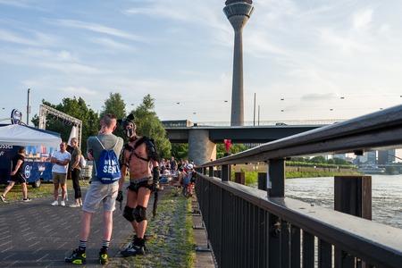Duesseldorf, Germany - June 04, 2018: Men celebrating at the Gay Pride party at the Rhine river. Standard-Bild - 104687719
