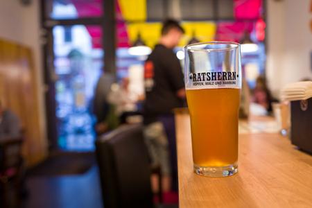 Hamburg, Germany - June 23, 2018: A Ratsherrn beer in a bar in Hamburg. Standard-Bild - 104687735
