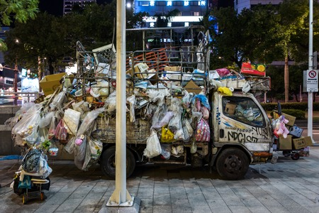 Taipei, Taiwan - September 19, 2018: An abandoned garbage truck at night.