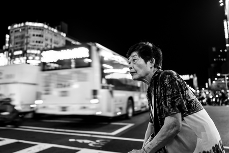 Taipei, Taiwan - October 01, 2018: An old woman on the streets of Taipei.