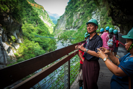 Taroko Gorge, Taiwan - September 21, 2018: Visitors with helmets at the Taroko Gorge National Park.
