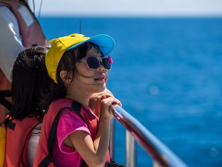 Hualien, Taiwan - September 22, 2018: A girl looking for dolphins at the coast of Hualien.