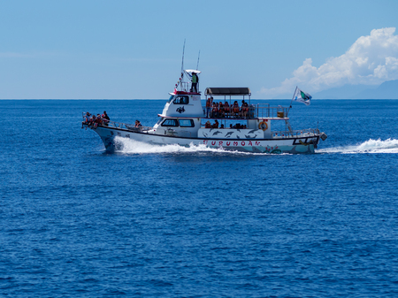 Hualien, Taiwan - September 22, 2018: A whale watching boat with tourists. Редакционное