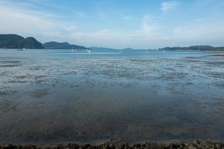 Low tide at Langkawi beach Фото со стока - 120512478