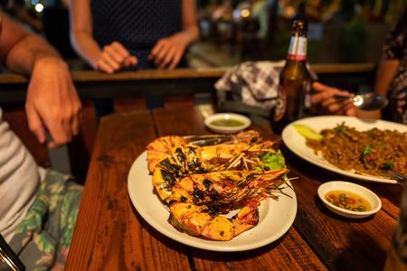Thai food with Tiger prawns on Koh Lipe in Thailand Фото со стока - 120512563