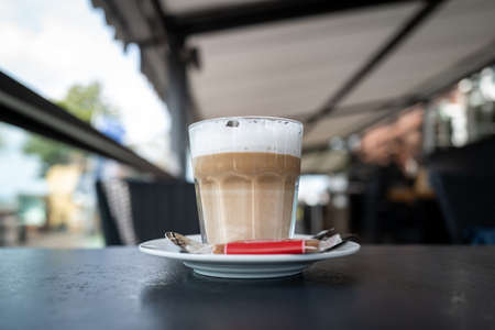 A glass of coffee with milk
