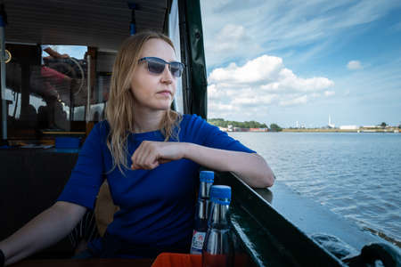 A girl watching the harbour of Wilhelmshaven Standard-Bild