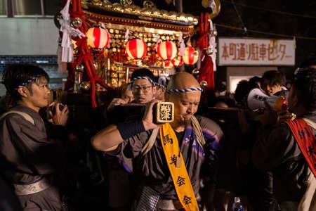 Kawaguchiko, Japan - September 19, 2019: People carrying a Mikoshi in Kawaguchiko. Editorial