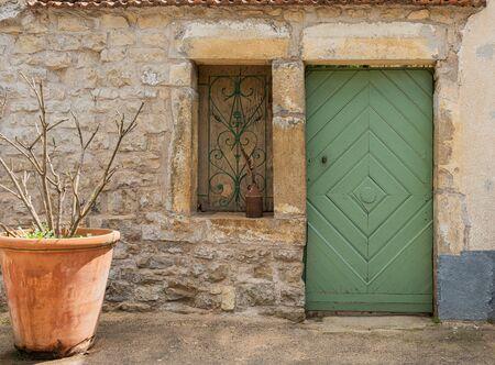 old weathered door with window 写真素材