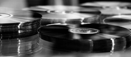 recordable media: black CD, DVD, Blue Ray stack