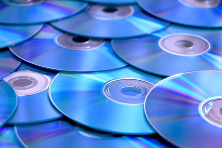 optical disk: blue CD, DVD, Blue Ray stack