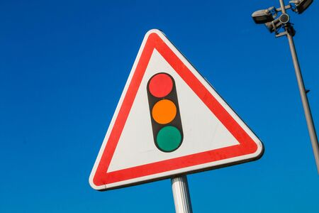 trafic: warning sign with a picture of a traffic signal on blue sky