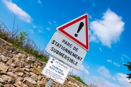 flooding: warning sign on Noirmoutier, France slipway for parking one side only and liable to flooding Stock Photo